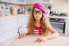 Little girl with glasses and red beret Stock Photography