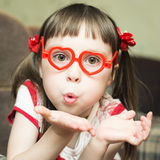 Little girl with glasses in the shape of a heart Stock Photography