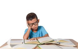 Little girl with glasses thought and many book on the table. back to school concept, isolated on white background stock photos