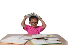 Little girl with glasses thought and many book on the table. back to school concept, isolated on white background stock images