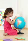 The little girl with globe. Employment in a kindergarten Stock Photo