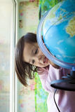 A little girl and the globe Stock Images