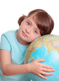 Little girl with globe. Isolated on white Stock Image