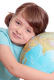 Little girl with globe. Isolated on white Stock Images