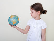 The little girl  and globe. The little girl studying a globe Royalty Free Stock Photo