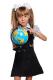 Little girl with globe. Little girl in school uniform with globe of the world isolated on white background Royalty Free Stock Photography