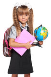 Little girl with globe. Little girl in school uniform with globe of the world and book isolated on white background Stock Photography