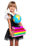 Little girl with globe. Little girl with books and globe of the world isolated on white background Stock Photo