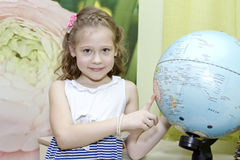 Little girl with globe. Little girl showing country on the globe Royalty Free Stock Images