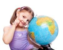 Little girl with globe. Studio photo of little girl with globe Stock Photography