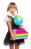 Little girl with globe and books Royalty Free Stock Photos