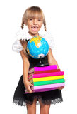 Little girl with globe. Happy little girl with books and globe of the world isolated on white background Royalty Free Stock Photos