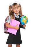 Little girl with globe. Happy little girl with books and globe of the world isolated on white background Royalty Free Stock Photography