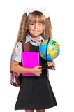 Little girl with globe. Happy little girl with books and globe of the world isolated on white background Stock Photography