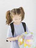 Little girl with globe Stock Photography