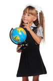 Little girl with globe. Little girl in school uniform with globe of the world isolated on white background Royalty Free Stock Image