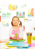 Little girl with glue stick Royalty Free Stock Images