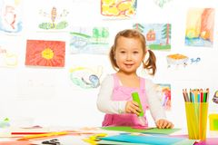 Little girl gluing Stock Image
