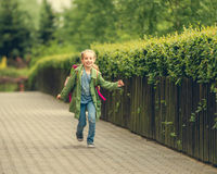 Little girl go home from school Royalty Free Stock Photo
