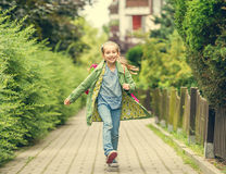 Little girl go home from school Stock Image