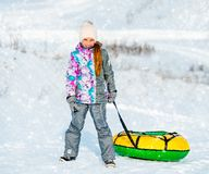 Little Girl Goes For Winter Slide Royalty Free Stock Photos