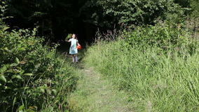 Little girl goes from the forest stock footage