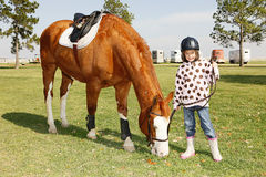 Little girl goes horse riding Royalty Free Stock Photography
