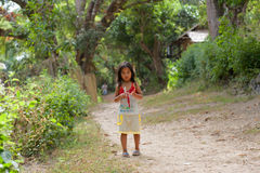 Little girl goes on road in the Philippine village Royalty Free Stock Photo