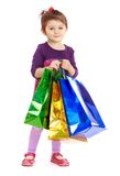 Little girl goes shopping with large colored Royalty Free Stock Image