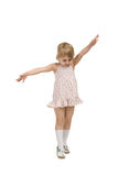 Little girl goes on tiptoe Royalty Free Stock Images