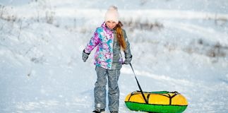 Little girl goes for winter slide stock images