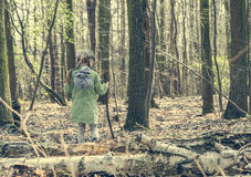 Little girl goes through the woods Royalty Free Stock Photography