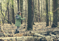 Little girl goes through the woods Stock Photos
