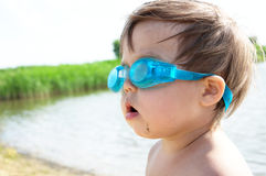 Little girl with goggles on the lake Stock Photo