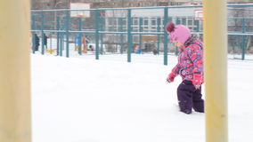 Little Girl Going in Deep Snow on Playground stock video footage