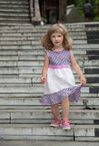 Little girl  going down the stone steps Stock Photo