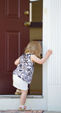 Little Girl Going into Home royalty free stock images