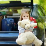 Little girl going to a car vacation Royalty Free Stock Photography