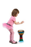 Little girl going to play on Djembe Stock Images