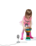 Little girl going to play on Djembe Stock Photography