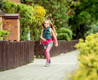 Little girl  going to school Stock Images