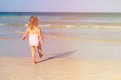 Little girl going to swim at beach Royalty Free Stock Image