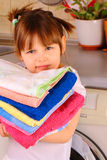 A little girl is going to wash the towels Royalty Free Stock Images