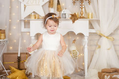 Little girl in a gold dress royalty free stock photos