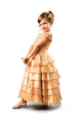 Little girl in gold gown isolated on white Royalty Free Stock Photo
