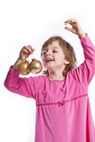 Little girl with golden christmas balls Royalty Free Stock Photography