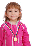 Little girl with golden medal winner Royalty Free Stock Photos