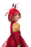 Little girl in golden and red dress Stock Images