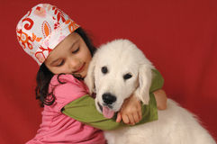 Little girl with a Golden retriever Stock Images
