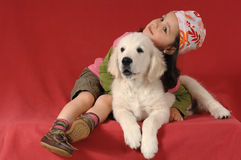 Little girl with a Golden retriever Royalty Free Stock Image